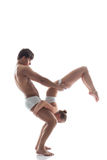 Duo of acrobats showing trick, isolated on white Stock Images