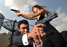 Duo Agent/Killer attacking/defending the situation Royalty Free Stock Photos