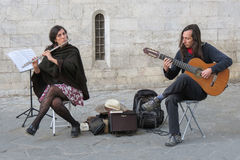 Duo busking on a square Stock Image