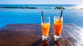 Duo of Cocktails. In the sun on the bay, holidays royalty free stock image