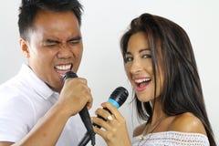 Duo de karaoke Photographie stock
