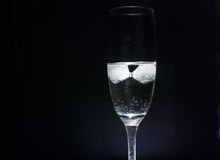 Duo. Icecubes in a glass of sparkling wine Stock Photo