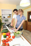 Duo in the kitchen. Preparing a meal royalty free stock image