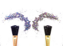 Duo makeup brush with mixed color eyeshadow powder. stock photography