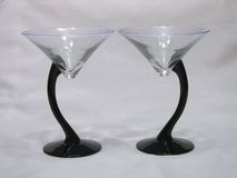 Duo of Martini Glasses. Two martini glasses side by side, turned opposite directions Stock Photo