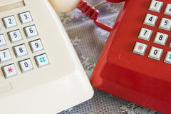 Duo old telephone. In red and white color stock photography