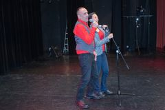 Duo singing on stage. Duo singing on the stage stock photo