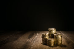 Piles of gold coins Stock Image