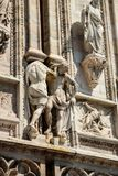 Everyday life of sculptures. Duomo Cathedral Milans outside sculptures, The everyday life of sculptures Royalty Free Stock Photos