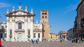Duomo Cathedral on Piazza Sordello in Mantua. MANTUA, ITALY - MARCH 31, 2017: people and Mantova Duomo Cathedral on Piazza Sordello Piazza San Pietro in Mantua Royalty Free Stock Image