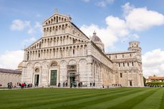 Duomo cathedral of Pisa, with the Leaning Tower behind. Tuscany, Italy. View of the iconic Piazza dei Miracoli Piazza del Duomo, with the cathedral in front, and royalty free stock photos