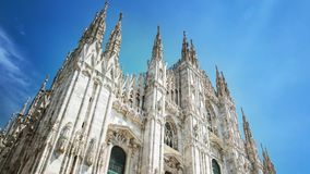 Duomo cathedral timelapse. Front view on square. Gothic architecture. MILANO, ITALY - MAY 3, 2017: The Duomo cathedral timelapse hyperlapse. Front view on stock video