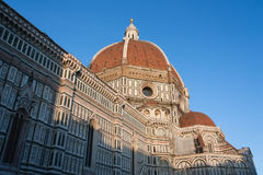 Duomo di Firenze. Florences cathedral stands tall over the city with its magnificent Renaissance dome designed by Filippo Brunelleschi. The cathedral named in royalty free stock photos
