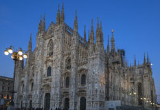 Duomo di Milano. The Cathedral of Milan at evening time surrounded by a wonderful blu bright and clear sky, Milan, Italy stock photography