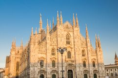 Duomo di Milano cathedral on Piazza del Duomo square, Milan, Italy. Duomo di Milano cathedral facade with white walls, high windows, spires, mouldings and stucco stock image