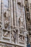 Vertical detail of upper section of the Duomo di Milano populated with statuary. The Duomo di Milano has more statues attached to the building than any other in Stock Photo