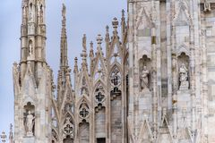 Detail of upper section of the Duomo di Milano populated with statuary. The Duomo di Milano has more statues attached to the building than any other in the Royalty Free Stock Image