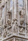 Vertical detail of upper corner section of the Duomo di Milano populated with statuary. The Duomo di Milano has more statues attached to the building than any Royalty Free Stock Photo
