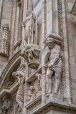 Vertical detail of upper section of the Duomo di Milano populated with statuary. The Duomo di Milano has more statues attached to the building than any other in Stock Image