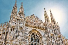 Duomo di Milano in Milan, Italy. The famous Milan Cathedral Duomo di Milano on a sunny day in Milan, Italy. Milan Duomo is the largest church in Italy and the Stock Images