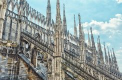 Duomo di Milano in Milan, Italy. The roof of the Milan Cathedral Duomo di Milano in Milan, Italy. Milan Duomo is the largest church in Italy and the fifth Stock Photo