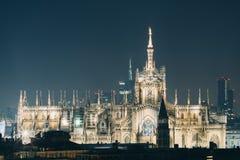Duomo di Milano with Milan Skyline by Night Royalty Free Stock Image