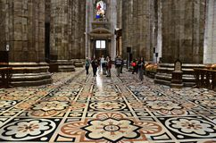 The floor of the Duomo di Milano, Italy. The Duomo di Milano`s basic floor design consists of large square tiles made of Candoglia marble with a geometric Stock Images