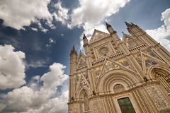 Duomo di Orvieto. Orvieto Cathedral under a deep blue clouded sky Stock Images