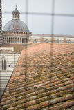 Duomo di Siena and bell tower. View from iron grid window. Tuscany, Italy. Royalty Free Stock Photos