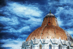 Duomo dome in Pisa under a cloudy sky Royalty Free Stock Photos