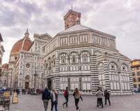 Duomo in Florece, Italy. FLORENCE, ITALY - Oct 10, 2016. Tourists on Piazza del Duomo in front of the cathedral of Florence - Dom Santa Maria del Fiore, bell Stock Image