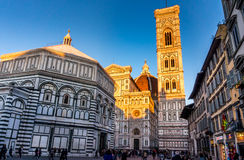 Duomo in Florece, Italy. FLORENCE, ITALY - Oct 5, 2016. Tourists on Piazza del Duomo in front of the cathedral of Florence - Dom Santa Maria del Fiore, bell Stock Images