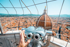 Duomo in Florence. Top view from the bell tower with binocular on the dome of Santa Maria del Fiore church and old town in Florence royalty free stock photography