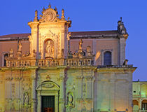 Duomo in Lecce. Duomo with artificial lighting at dusk in Lecce, Italy royalty free stock images