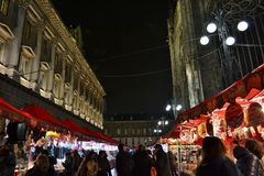 Duomo of Milan Christmas market with red gazebos, the Rinascente store and people walking. royalty free stock photo