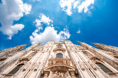 Duomo in Milan city. Main facade of the famous Duomo cathedral with the blue sky in Milan city in Italy royalty free stock images