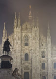 Duomo in Milan and statue stock photography