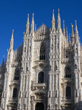 Duomo of Milan, Italy. Front view of Duomo, in Italy, with blue sky and the gold statue of madonna Royalty Free Stock Photos