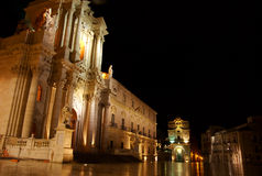 Duomo, Ortigia, Sicily. The Duomo, Ortigia, Sicily, on a rain-soaked morning before first light. In the background is the Church of Santa Lucia stock image