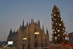 Duomo square decorated with the Christmas Tree and view on the Duomo in early New Year morning. royalty free stock image