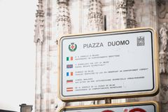 Duomo Square, a sign asks visitors to respect the place by observing the correct behavior stock photography