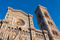 Duomo and Tower of Firenze. The Basilica di Santa Maria del Fiore (English: Basilica of Saint Mary of the Flower) is the main church of Florence, Italy. The Royalty Free Stock Images