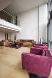 Duplex apartment. Contemporary duplex penthouse apartment with mezzanine and nice frniture Stock Image
