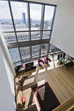 Duplex apartment with city views. Duplex apartment with two floors large windows and city views Royalty Free Stock Image