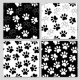 Set of black and white vector backgrounds with paw print. Duplicate patterns and textures can be used for printing onto fabric, vector illustration