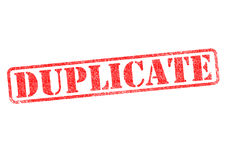 DUPLICATE. Red rubber stamp over a white background Stock Photography