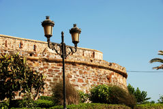 Duquesa castle, Spain. View of the castle with a traditional streetlight in the foreground, Duquesa, Malaga Province, Andalucia, Spain, Western Europe stock photos