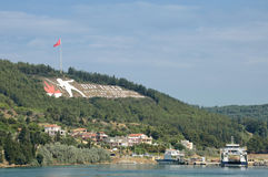 Dur Yolcu Sign on Kilitbahir Hills , Canakkale, Turkey. CANAKKALE, TURKEY, JULY 17,2014: Dur Yolcu Memorial Sign on the hillside above Kilitbahir,the sign's Stock Images