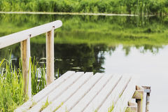 , durable wooden dock on the river for fishing royalty free stock image