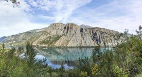 The durance lake at lac de Serre Poncon in the Alps Stock Photo